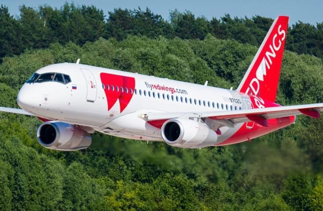 Самолет Superjet 100 в новой ливрее авиакомпании Red Wings