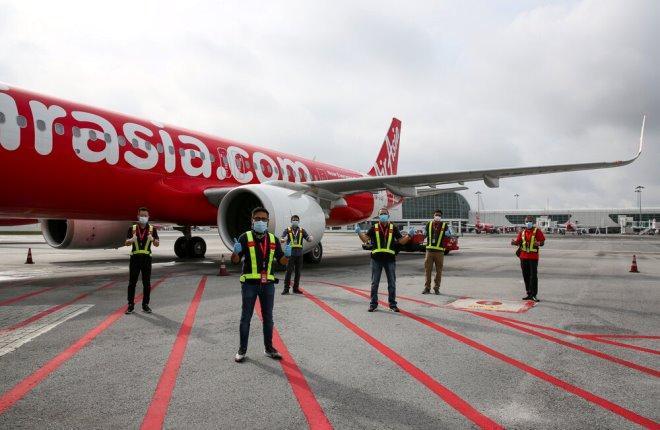 Первый рейс AirAsia после простоя в месяц
