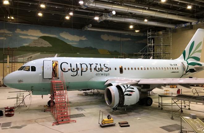 Самолет Airbus A319 в обновленной ливрее авиакомпании Cyprus Airways в покрасочном ангаре