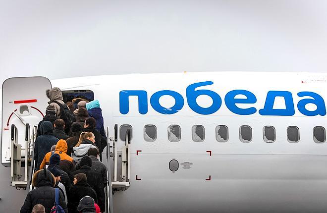 """Посадка пассажиров в самолет Boeing 737-800 авиакомпании """"Победа"""""""